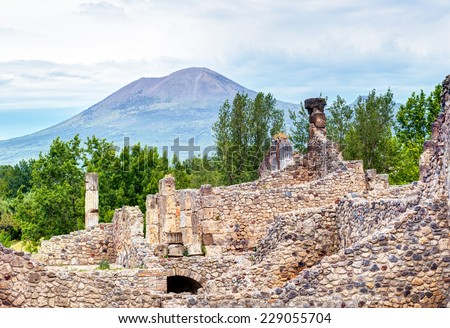 Ruins of Pompeii with Vesuvius in the distance, Italy. Pompeii is an ancient Roman city died from the eruption of Mount Vesuvius in 79 AD.  - stock photo