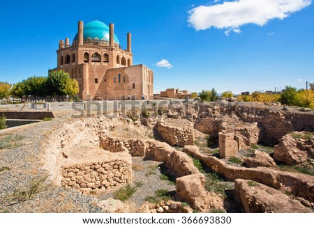 Ruins of protective walls and building of 14th century mausoleum Dome of Soltaniyeh near Zanjan city, Iran. UNESCO World Heritage Site, anticipating the Taj Mahal, erected from 1302 to 1312 AD.  - stock photo