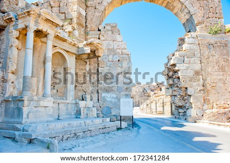 Ruins of Side in Turkey, arch of white stone - stock photo