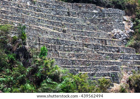 ruins of terraces on the mountain of Machu Picchu - stock photo