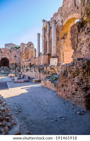 Ruins of the ancient greek theater with Corinthian columns in Taormina, Sicily - stock photo