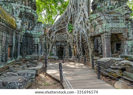 Ruins of the ancient Khmer temple of Ta Prohm. - stock photo