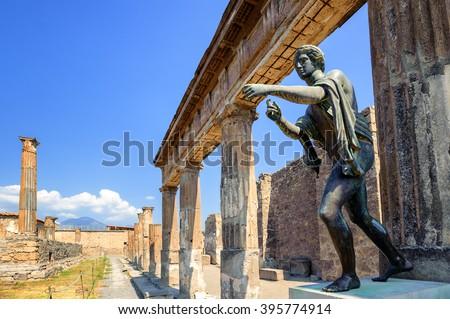 Ruins of the antique Temple of Apollo with bronze Apollo statue in Pompeii, Naples, Italy. Pompeii was destroyed by Vesuvius eruption in 79 AD. - stock photo