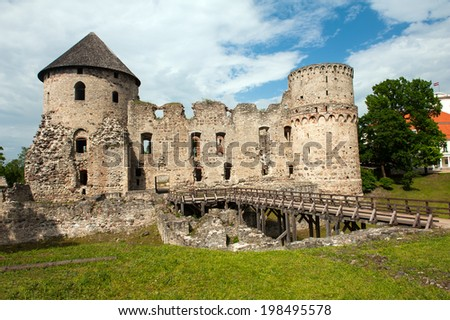 Ruins of the beautiful castle in town of Cesis was a residence of the Livonian order (teutonic knights) in the middle ages, Latvia - stock photo