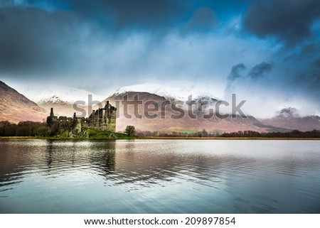Ruins of the castle on the lake - stock photo