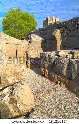 Ruins of the labyrinth entrance to an antique temple, Greece - stock photo