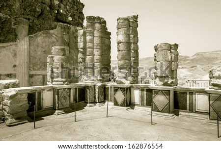 Ruins of the North Palace of ancient Masada fortress near Dead Sea - Israel (stylized retro) - stock photo