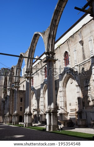 Ruins of the 14th-15th century Gothic church Igreja do Carmo in Lisbon, Portugal. Damaged by the earthquake in 1755. - stock photo