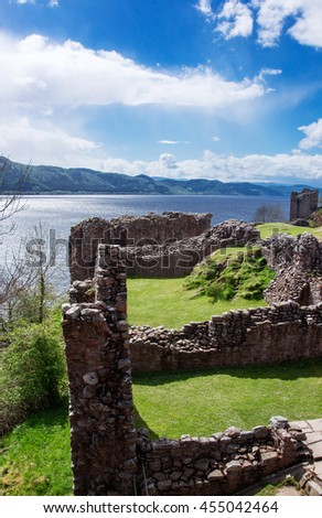 Ruins of the Urquhart Castle at Loch Ness in Scotland. Loch Ness is a city in the Highlands in Scotland in the United Kingdom. - stock photo