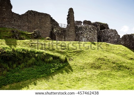 Ruins of the Urquhart Castle at Loch Ness, in Scotland. Loch Ness is a city in the Highlands in Scotland in the United Kingdom. - stock photo