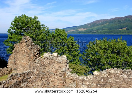 Ruins of Urquhart Castle and Loch Ness in the Highlands of Scotland - stock photo