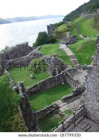 Ruins of Urquhart Castle at Loch Ness - stock photo