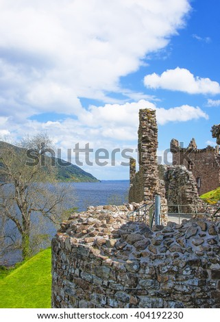 Ruins of Urquhart Castle in Loch Ness in Scotland. Loch Ness is a city in the Highlands in Scotland in the United Kingdom. - stock photo