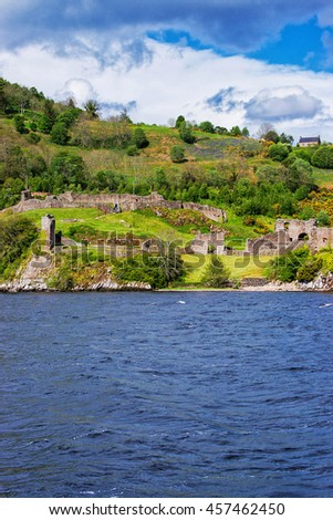 Ruins of Urquhart Castle in Loch Ness,  Scotland. Loch Ness is a city in the Highlands in Scotland in the United Kingdom. - stock photo
