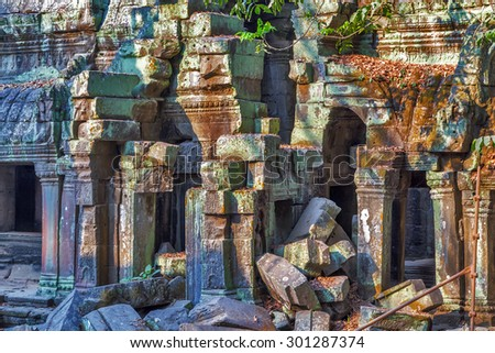 Ruins stone of Angkor Wat, part of Khmer temple complex, Asia. Siem Reap, Cambodia. Ancient Khmer architecture in jungle. - stock photo