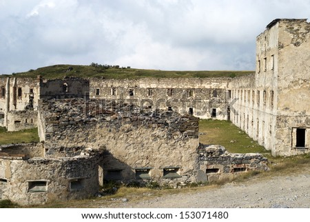 Ruins the old military fortification in Alps - stock photo
