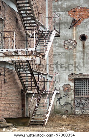 ruins, view of an old wall abandoned factory building - stock photo