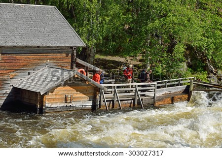 RUKA, FINLAND - JULY 7,2015:Old watermill at Myllykoski used to grind barley and rye until late 1940s. Today it serves as rest hut for hikers with open fireplace and scenic views of Myllykoski Rapids