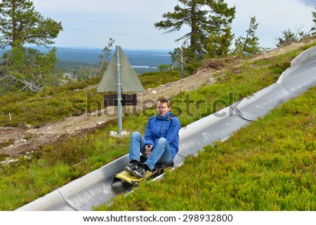 Ruka Sled Track is exciting way to descend mountain: run is 1 km long and offers speeds up to 60 km/h - stock photo