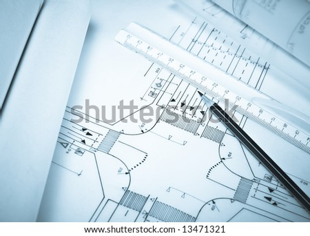 Rule and pencil against road plan. Blue tone. Shallow DOF. - stock photo
