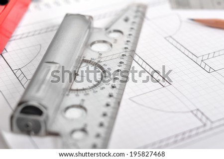 ruler and apartment blueprint  on the table