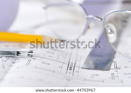 Ruler, eraser, glasses and a pencil on the floor plan - Business a still-life