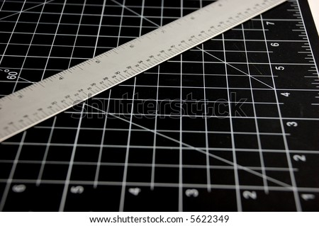 Ruler on Black Cutting Mat - stock photo