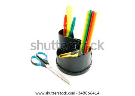 ruler, scissors and other stationery on white background