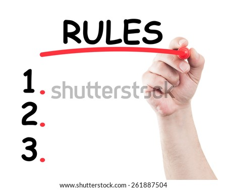 Rules list concept made by a human hand holding a marker on transparent wipe board - stock photo