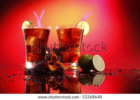 Rum and coke - Cuba Libre - with exotic chips - stock photo