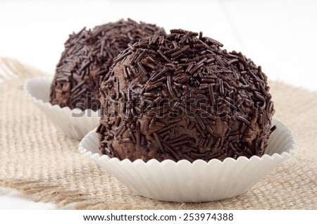 rum ball in a paper case on jute