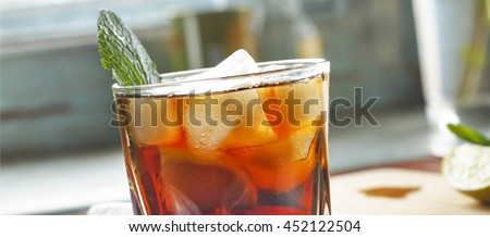 rum in a glass with ice