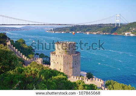 Rumelihisari with the Fatih Sultan Mehmet Bridge in the background in Istanbul, Turkey - stock photo
