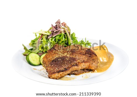 Rump steak with mashed potatoes and mix vegetable on plate isolated on white background - stock photo
