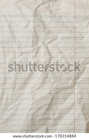Rumpled vintage sheet of lined paper or notebook paper with right margin - stock photo