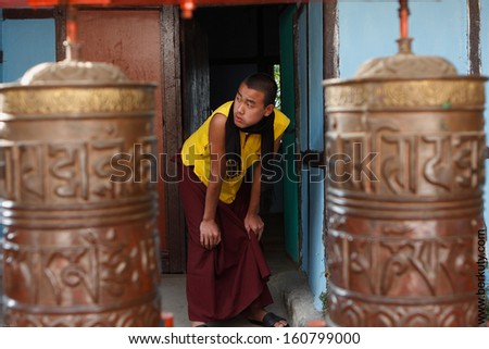 RUMTEK, INDIA - DEC 5: Monk in the Rumtek Monastery on Dec 5, 2008 in Rumtek, India. also called the Dharmachakra Centre, is a Tibetan Buddhist monastery located in the Indian state of Sikkim. - stock photo