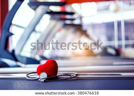 Run on Treadmill Workout for heart Health strong in gym and fitness - stock photo