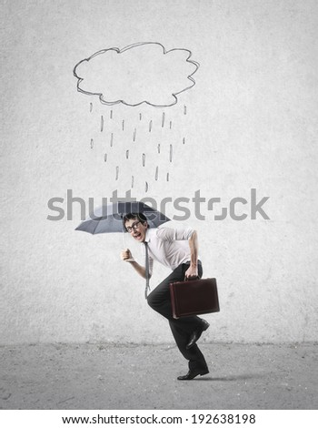 run with umbrella - stock photo