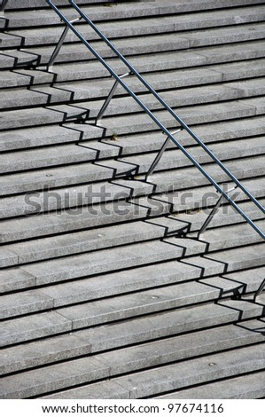 Rung of the Stairs with stainless steel handrails. A fragment with a clear shadow. The simple geometry. - stock photo