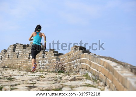 Runner athlete running on chinese great wall . woman fitness jogging workout wellness concept.  - stock photo