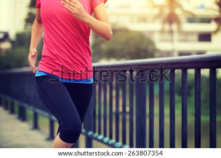 Runner athlete running on iron bridge. woman fitness jogging workout wellness concept.  - stock photo