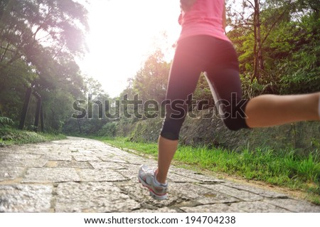 Runner athlete running on sunrise road. woman fitness jogging workout wellness concept.