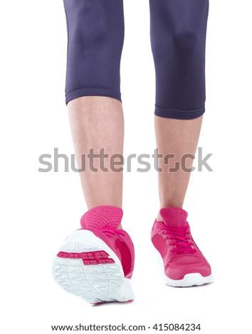 Runner feet running on road closeup on shoe. workout wellness concept. - stock photo