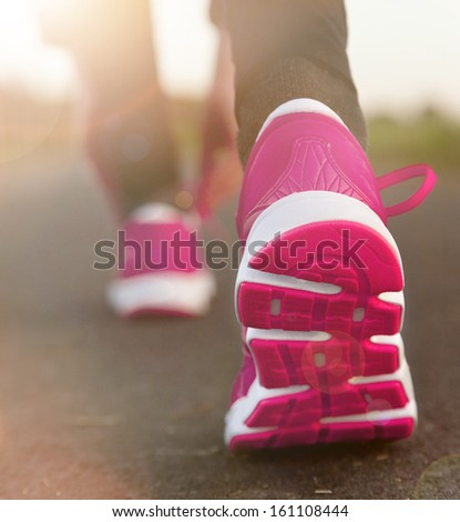 Runner feet running on road. Shoe close-up. - stock photo
