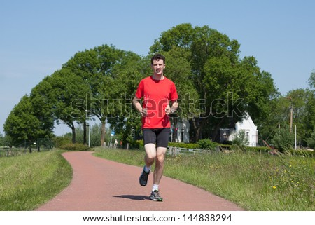 Runner in a Dutch polder (Eemnes, the Netherlands)