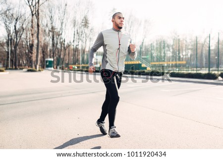 Runner in motion, speed running, healthy lifestyle
