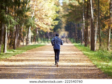 runner in the autumn forest  - stock photo