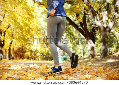 Runner legs outside during autumn day. - stock photo