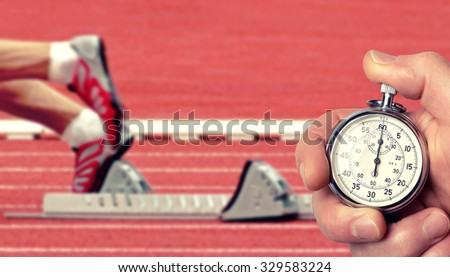 runner lined up ready to race, Historic stop watch time measurement