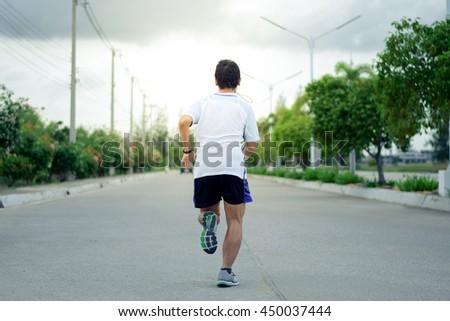 Runner man on street - stock photo